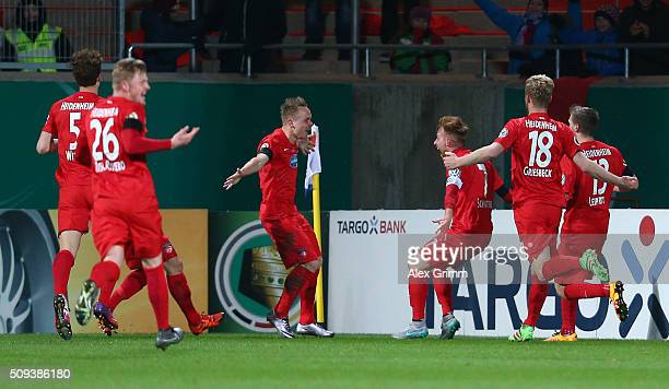 Arne Feick Of 1FC Heidenheim celebrates scoring his side's first goal during the DFB Cup quarter final match between 1 FC Heidenheim and Hertha BSC...