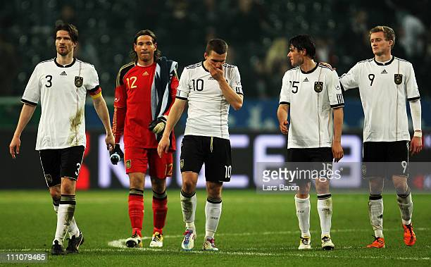 Arne Friedrich goalkeeper Tim Wiese Lukas Podolski Christian Traesch and Andre Schuerrle of Germany are looking dejected after loosing the...