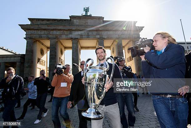 Arne Friedrich holds the cup in front of the Brandenburg Gate during the UEFA Champions League Trophy Tour Berlin on April 29 2015 in Berlin Germany