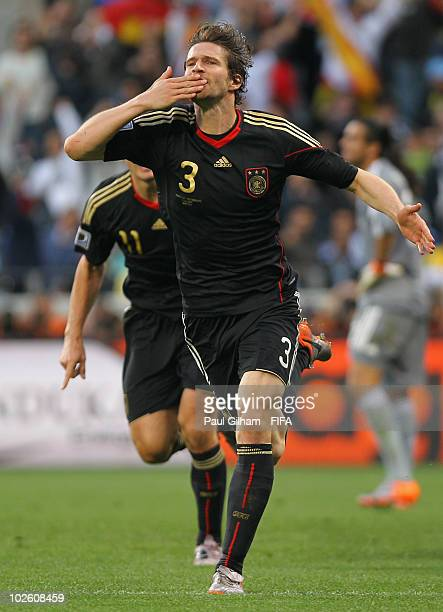 Arne Friedrich of Germany celebrates after scoring their third goal during the 2010 FIFA World Cup South Africa Quarter Final match between Argentina...