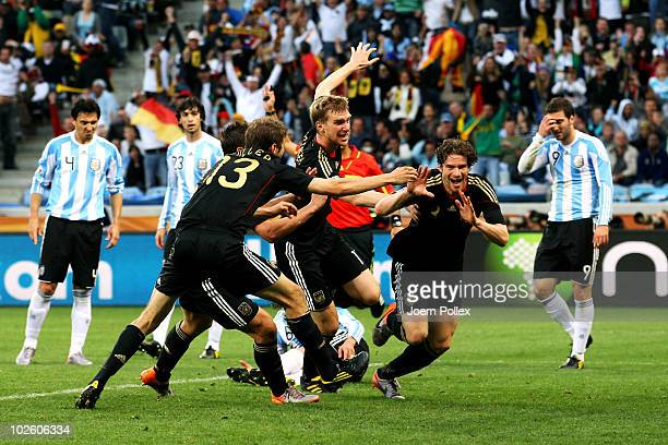 Arne Friedrich of Germany celebrates scoring his team's third goal during the 2010 FIFA World Cup South Africa Quarter Final match between Argentina...