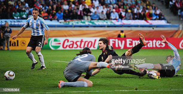 Arne Friedrich of Germany scores his team's third goal past Sergio Romero of Argentina during the 2010 FIFA World Cup South Africa Quarter Final...