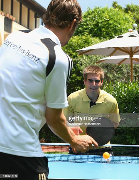 Arne Friedrich plays table tennis with his team mate Philipp Lahm at the German team squad hotel Il Giardino on June 21 2008 in Ascona Switzerland