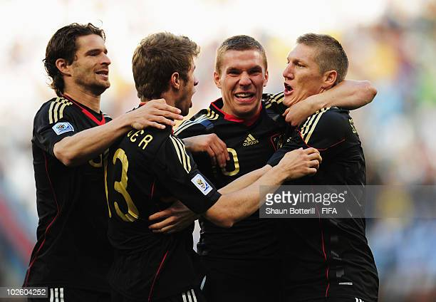Arne Friedrich Thomas Mueller Lukas Podolski and Bastian Schweinsteiger of Germany celebrate after Thomas Mueller scores the opening goal during the...