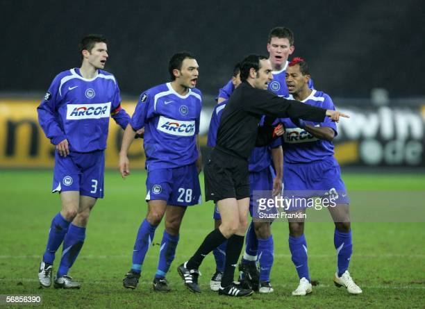 Arne Friiedrich Sofian Chahed Aleaxander Madlung and Marcelinho of Berlin protest to referee Eduardo Iturralde Gonzales after his teammate...