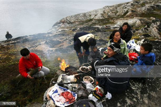 Arne Lange a 39yearold Inuit fisherman and his family have a family seal meat barbeque August 26 2007 on an island near the village of Ilimanaq...