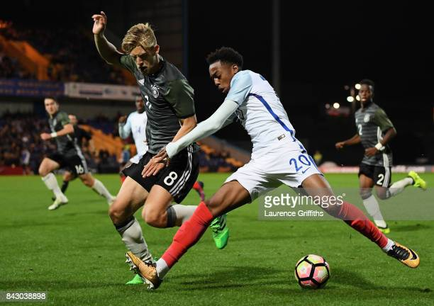Arne Maier of Germany and Joe Willock of England compete for the ball during the U19 International match between England and Germany at One Call...