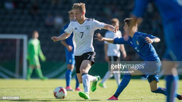 Arne Maier of Germany is challenged by Filippo Melegoni of Italy during the U18 International Friendly match between Germany and Italy on May 17 2017...