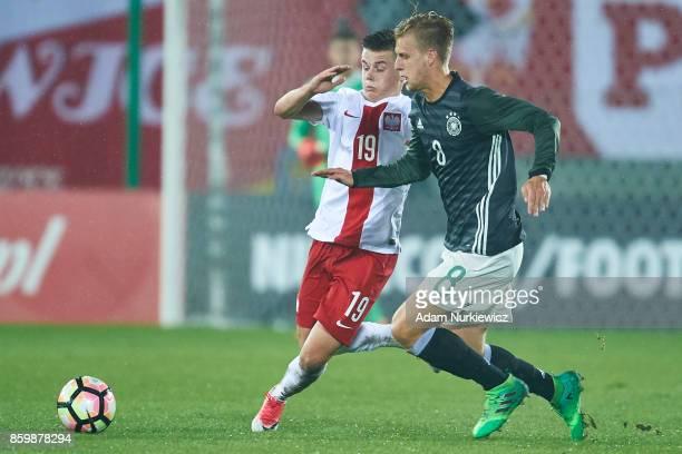 Arne Maier of U19 Germany fights for the ball with Adrian Lyszczarz of U19 Poland during soccer match U19 Poland v U19 Germany UEFA Under19 Euro...