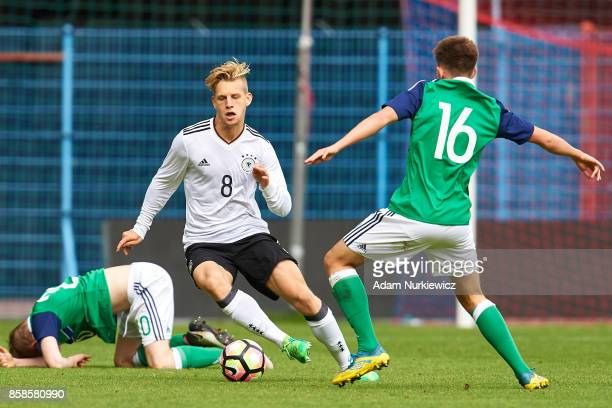 Arne Maier of U19 Germany fights for the ball with Caolan Boyd Munce of U19 Northern Ireland during soccer match U19 Germany v U19 Northern Ireland...