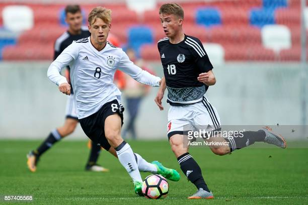 Arne Maier of U19 Germany fights for the ball with Ilya Vasilevich of U19 Belarus during the UEFA Under19 Euro Qualifier between U19 Germany and U19...