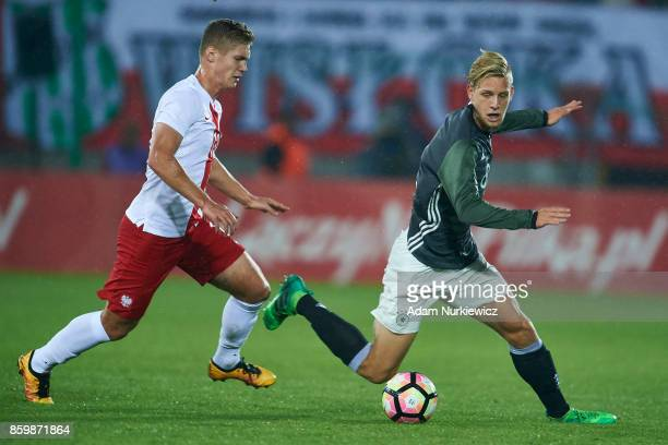 Arne Maier of U19 Germany fights for the ball with Radoslaw Kanach of U19 Poland during soccer match U19 Poland v U19 Germany UEFA Under19 Euro...