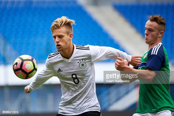 Arne Maier of U19 Germany fights for the ball with Robert Burns of U19 Northern Ireland during soccer match U19 Germany v U19 Northern Ireland UEFA...