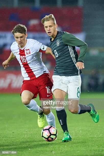 Arne Maier of U19 Germany fights for the ball with Serafin Szota of U19 Poland during soccer match U19 Poland v U19 Germany UEFA Under19 Euro...