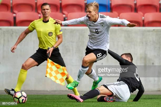 Arne Maier of U19 Germany fights for the ball with Vladimir Starostin of U19 Belarus during soccer match U19 Germany v U19 Belarus UEFA Under19 Euro...