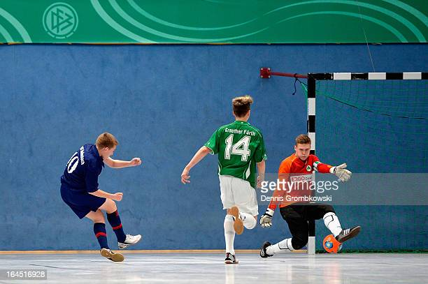 Arne Schuelke of Hollenbach scores a goal in the DFB C Juniors Futsal Cup semifinal match between SpVgg Greuther Fuerth and FSV Hollenbach on March...