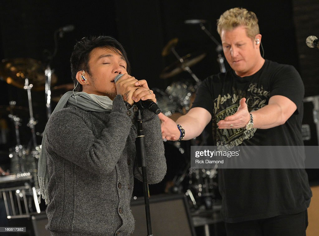 Arnel Pineda of Journey, Gary LeVox of Rascal Flatts and Neal Schon of Journey perform during CMT Crossroads: Journey and Rascal Flatts Live from Super Bowl XLVII rehearsals on February 1, 2013 in New Orleans, Louisiana.