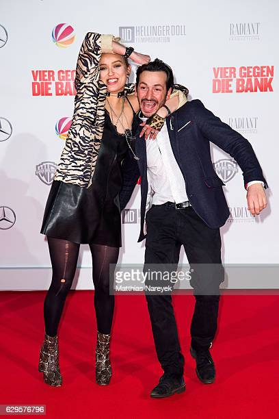 Arnel Taci and Caro Cult attend the German premiere of the film 'Vier gegen die Bank' at CineStar on December 13 2016 in Berlin Germany