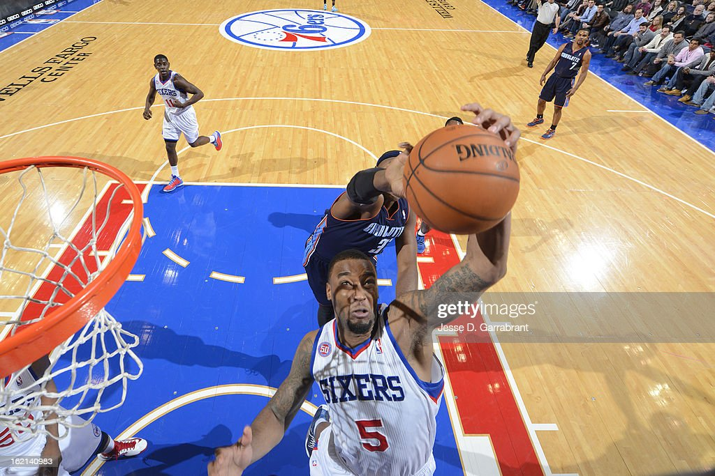 Arnett Moultrie #5 of the Philadelphia 76ers grabs a rebound against the Charlotte Bobcats at the Wells Fargo Center on February 9, 2013 in Philadelphia, Pennsylvania.