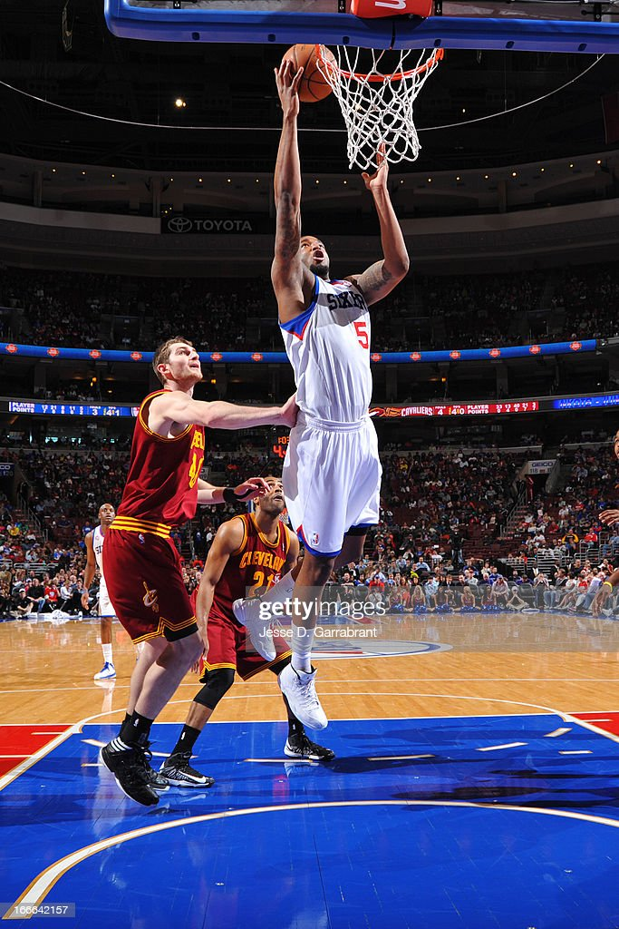 Arnett Moultrie #5 of the Philadelphia 76ers shoots a layup against Tyler Zeller #40 and Wayne Ellington #21 of the Cleveland Cavaliers at the Wells Fargo Center on April 14, 2013 in Philadelphia, Pennsylvania.