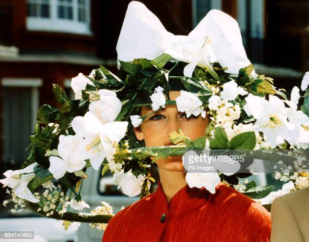 Arnica models a white Lillies roses and trellis work hat designed by Joan Giggs on the theme of an 'Enchanted Garden' the hat costs 500