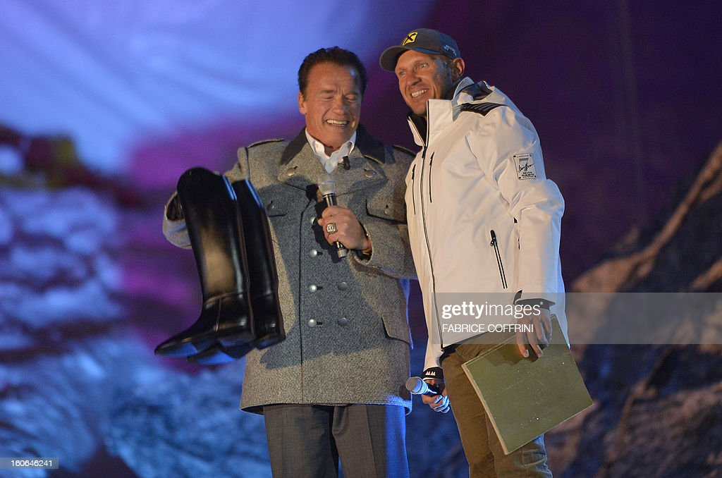 Arnold Alois Schwarzenegger (L), an Austrian and American former professional bodybuilder, actor, businessman, investor, and politician and Hermann Maier, a former World Cup champion alpine ski racer and Olympic gold medalist from Austria attend the opening ceremony of the FIS World Ski Championships on February 4, 2013 in Schladming.