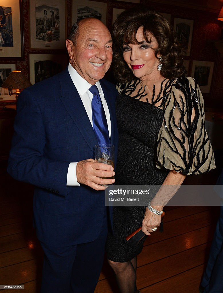 Arnold Crook (L) and Dame Joan Collins attend the launch of Dame Joan Collins' new book 'The St. Tropez Lonely Hearts Club' at Harry's Bar on May 5, 2016 in London, England.