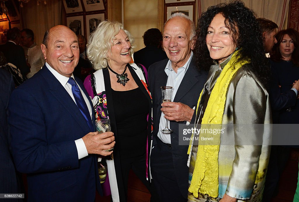 Arnold Crook, Jeanne Mandry, Richard Polo and Tricia Giuld attend the launch of Dame Joan Collins' new book 'The St. Tropez Lonely Hearts Club' at Harry's Bar on May 5, 2016 in London, England.