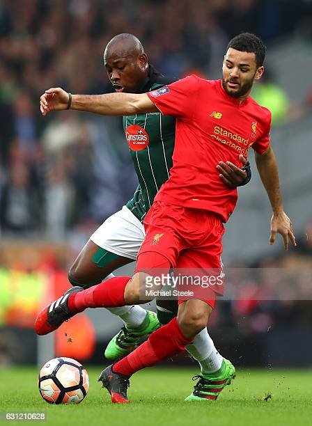 Arnold Garita of Plymouth Argyle and Kevin Stewart of Liverpool battle for possession during The Emirates FA Cup Third Round match between Liverpool...