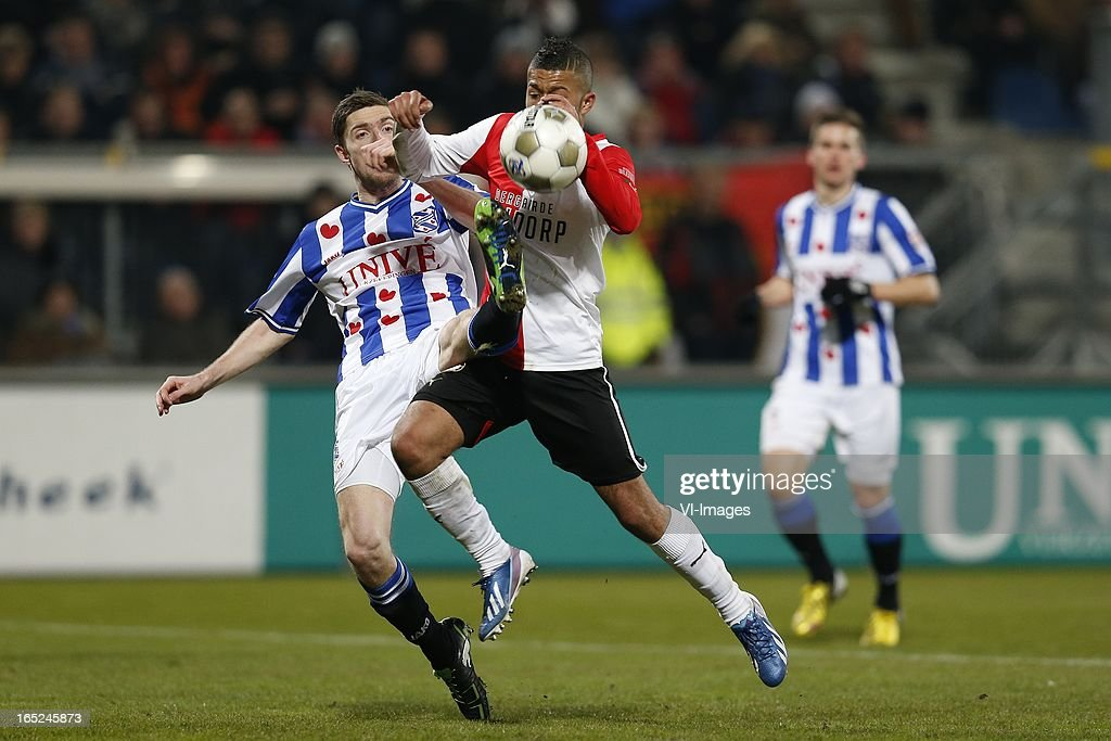 Arnold Kruiswijk of Heerenveen,Tony Vilhena of Feyenoord during the Dutch Eredivisie match between SC Heerenveen and Feyenoord at the Abe Lenstra Stadium on march 30, 2013 in Heerenveen, The Netherlands