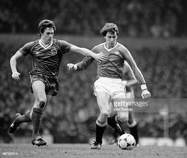 Arnold Muhren of Manchester United is challenged by Everton striker Kevin Sheedy during the FA Cup 6th round match held at Old Trafford Manchester on...