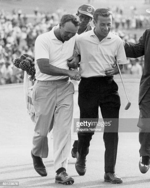 Arnold Palmer and Ken Venturi walk off the 18th green after finishing first and second in the 1960 Masters Tournament at the Augusta National Golf...