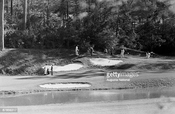 Arnold Palmer chips on the 12th hole during the 1961 Masters Tournament at Augusta National Golf Club in April 1961 in Augusta Georgia