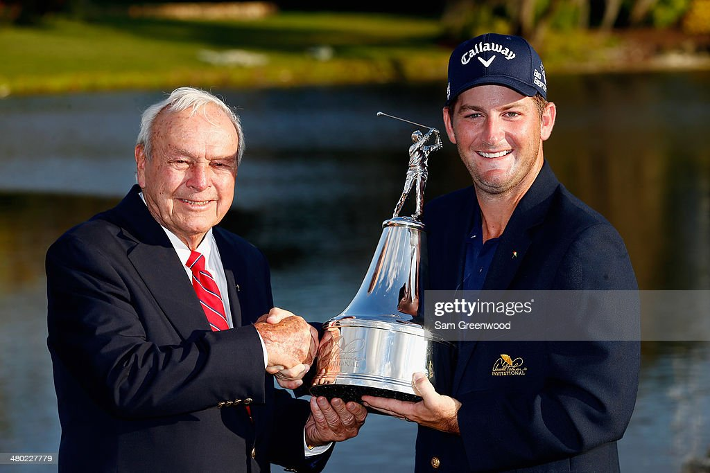 <a gi-track='captionPersonalityLinkClicked' href=/galleries/search?phrase=Arnold+Palmer&family=editorial&specificpeople=93096 ng-click='$event.stopPropagation()'>Arnold Palmer</a> congratulates <a gi-track='captionPersonalityLinkClicked' href=/galleries/search?phrase=Matt+Every&family=editorial&specificpeople=2344163 ng-click='$event.stopPropagation()'>Matt Every</a> of the United States as he celebrates with the trophy after winning the <a gi-track='captionPersonalityLinkClicked' href=/galleries/search?phrase=Arnold+Palmer&family=editorial&specificpeople=93096 ng-click='$event.stopPropagation()'>Arnold Palmer</a> Invitational presented by MasterCard at the Bay Hill Club and Lodge on March 23, 2014 in Orlando, Florida.