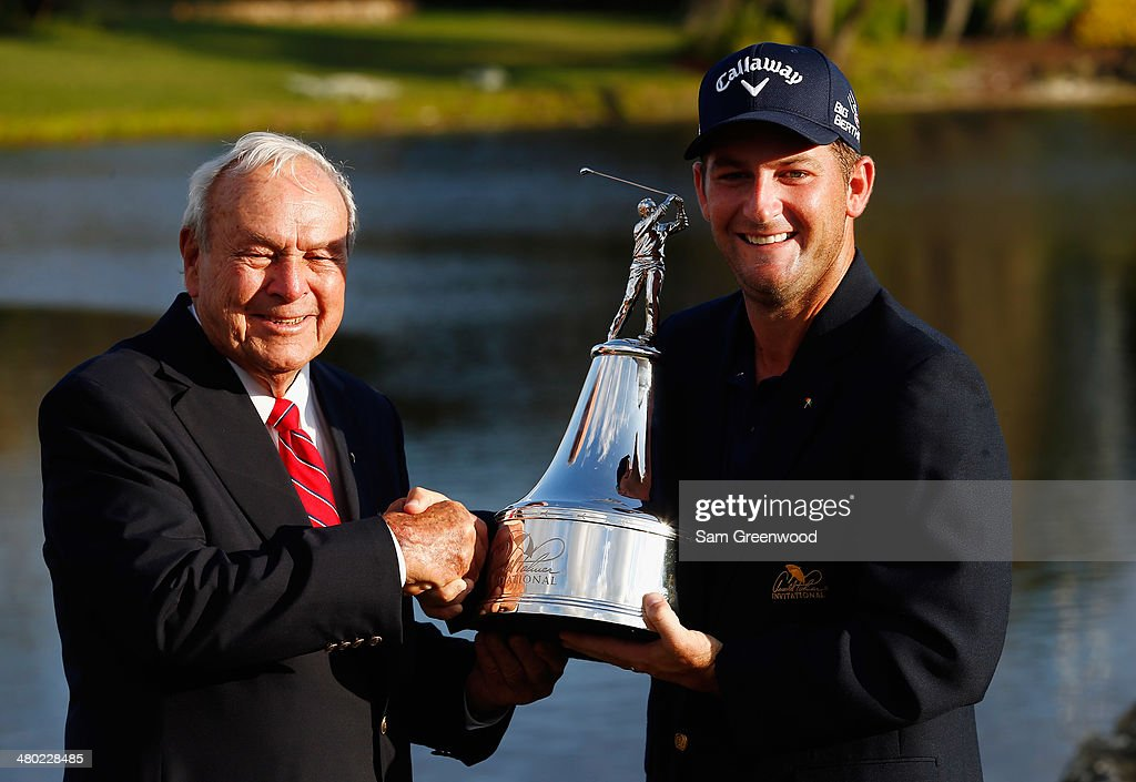 Arnold Palmer congratulates Matt Every of the United States as he celebrates with the trophy after winning the Arnold Palmer Invitational presented by MasterCard at the Bay Hill Club and Lodge on March 23, 2014 in Orlando, Florida.
