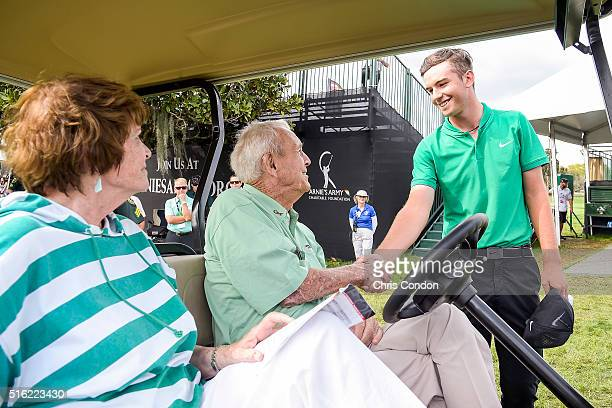 Arnold Palmer greets Ryan Ruffels of Australia during the first round of the Arnold Palmer Invitational presented by MasterCard at Bay Hill Club and...