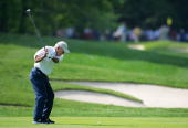 Arnold Palmer hits his second shot on the 6th hole during the second round of the Senior PGA Championship on May 27 2005 at Laurel Valley Golf Club...