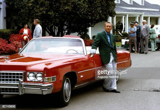 Arnold Palmer leans on a red Cadillac in his Grenn Jacket during the 1973 Masters Tournament at Augusta National Golf Club during April 1973 in...