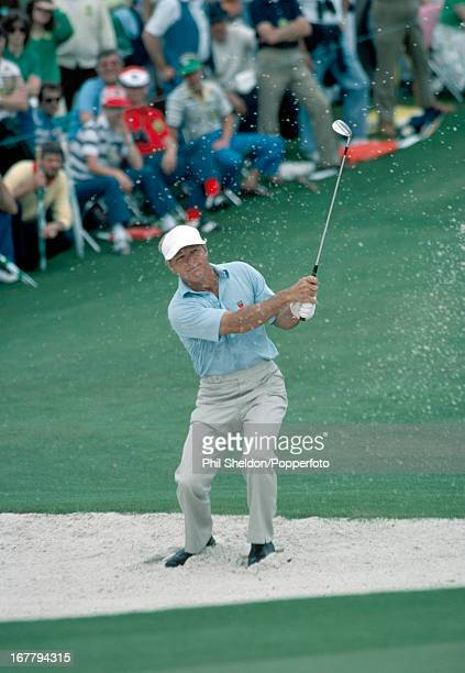 Arnold Palmer of the United States blasts out of a bunker during the US Masters Golf Tournament held at the Augusta National Golf Club in Georgia...