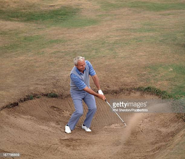 Arnold Palmer of the United States blasts out of a bunker during the British Open Golf Championship held at the Royal Troon Golf Club in Scotland...