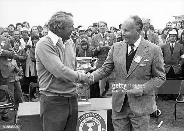Arnold Palmer of the United States is presented with his winners cheque during the final round of the Penfold PGA Championship held at Royal St...