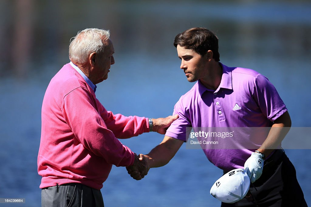 Arnold Palmer of the United States shakes hands with Casey Wittenberg of the United States during the first round of the 2013 Arnold Palmer Invitational Presented by Mastercard at Bay Hill Golf and Country Club on March 21, 2013 in Orlando, Florida.