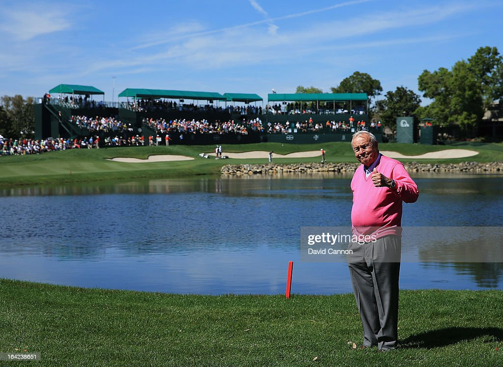 Arnold Palmer of the United States standing watching the golf beside the 18th hole during the first round of the 2013 Arnold Palmer Invitational Presented by Mastercard at Bay Hill Golf and Country Club on March 21, 2013 in Orlando, Florida.