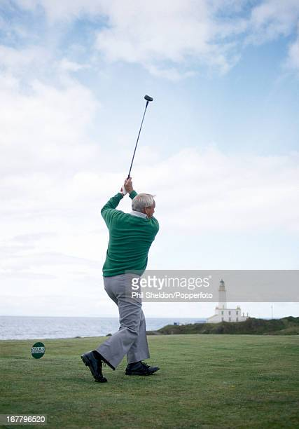 Arnold Palmer of the United States tees off during the Seniors Open Golf Championship held at the Turnberry Golf Club in Scotland circa 1987