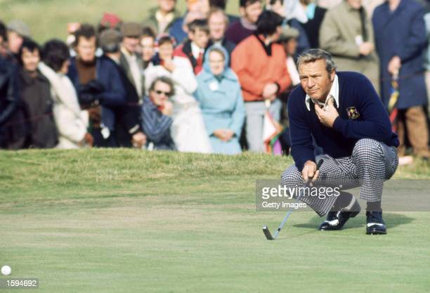 Arnold Palmer of the USA lines up a putt during the Ryder Cup between Europe and the USA at Murifield in Scotland in September 1973