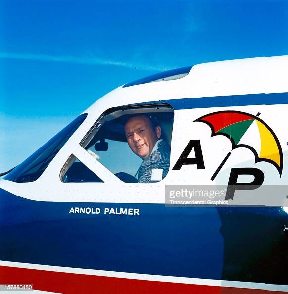 Arnold Palmer peers out the window of his personal airplane around 1965 in Latrobe Pennsylvania