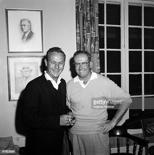 Arnold Palmer poses with Bob Rosburg in the clubhouse during the 1961 Masters Tournament at Augusta National Golf Club in April 1961 in Augusta...