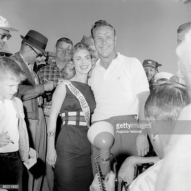 Arnold Palmer poses with Miss Golf during the 1958 Masters Tournament at Augusta National Golf Club in April in Augusta Georgia