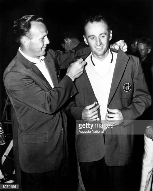 Arnold Palmer puts the green jacket on Art Wall Jr during the Presentation Ceremony in honor of his victory during the 1959 Masters Tournament at...