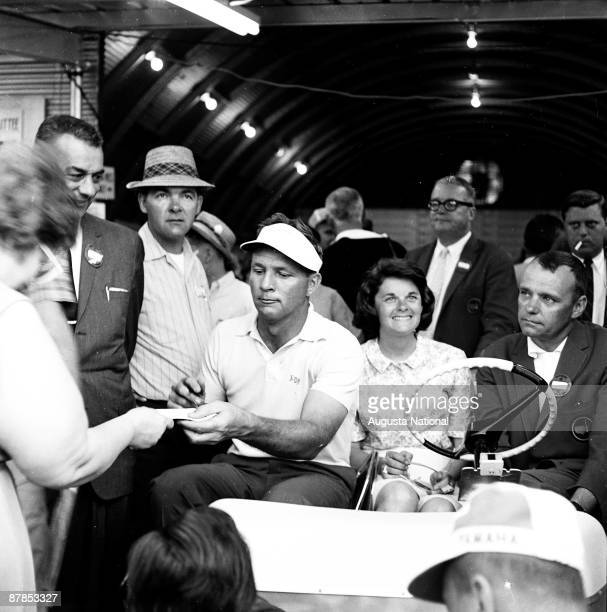 Arnold Palmer signs autographs after winning the 1964 Masters Tournament at Augusta National Golf Club in April 1964 in Augusta Georgia